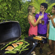 Royalty-Free Stock Photo: Three friends at a barbecue party in hawaii