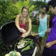 Stock Photo: Three friends at a barbecue party in hawaii