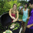Three friends at a barbecue party in hawaii — Stock Photo #4917468