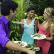 Three friends at a barbecue party in hawaii — Stock Photo #4917485
