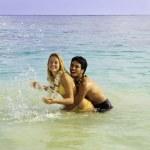 Couple in the ocean — Stock Photo #5040457