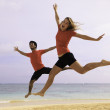 Couple jumping in the air — Stock Photo #5040672