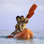 Couple paddling their kayak — Stock Photo #5061232