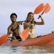 Couple paddling their kayak — Stock Photo