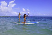 Japanese women with their paddle boards — Stock Photo