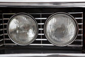 Closeup of the headlights of a car — Stock Photo