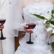 The groom and the bride with red wine glasses — Stock Photo #4373099