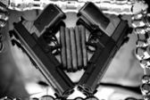 Pistol and cigars — Stock Photo