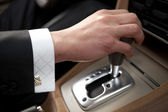 Hand of the driver of the car — Stock Photo