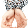 Hands chained in a chain - Stock Photo