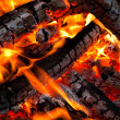 Burning coals on a grill - Stock Photo
