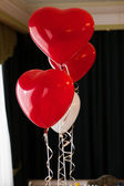 Red balloon in the form of heart — Stock Photo