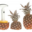 Whole and split pineapple with cutter — Stock Photo