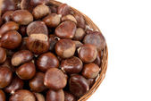 Wicker basket with chestnuts — Stock Photo