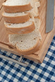 Slices of bread on top of wooden board — Stock Photo