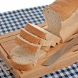 Slices of bread on top of wooden board — Stock Photo #4741071