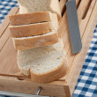 Slices of bread on top of wooden board — Stock Photo #4800159