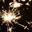 Stock Photo: Sparkler in focus