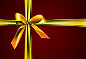 Gift with golden ribbon — Stock Photo