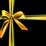 Golden ribbon on a black background — Stock Photo