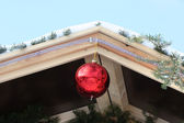 Christmas decorations on the roof — Stock Photo