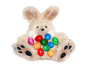 Easter bunny with lots of colorful eggs — Stock Photo