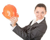 Woman in a business suit with helmet — Stock Photo