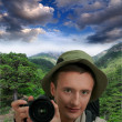 Young tourist with camera — Stock Photo