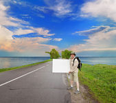 Tourist on a country road — Stock Photo