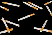 Cigarettes on a black background — Stok fotoğraf