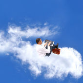 Businessman upon cloud — Stock Photo