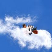 Kaufmann auf wolke — Stockfoto