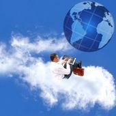 Zakenman op wolk — Stockfoto