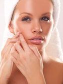 Spot on beauty woman face — Stock Photo