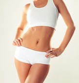 Slim tanned woman's body. — Stock Photo