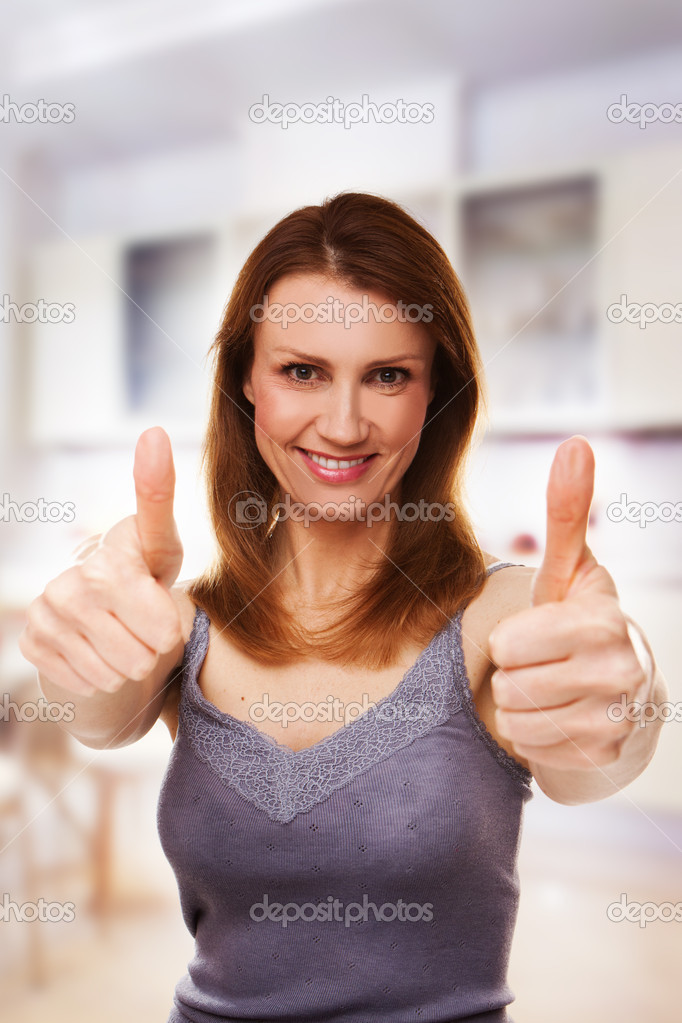 Middle-aged woman showing thumbs up  — Stock Photo #4213456