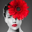 Red lips and red flower — Stock Photo