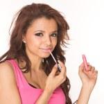Applying pink lipgloss — Stock Photo
