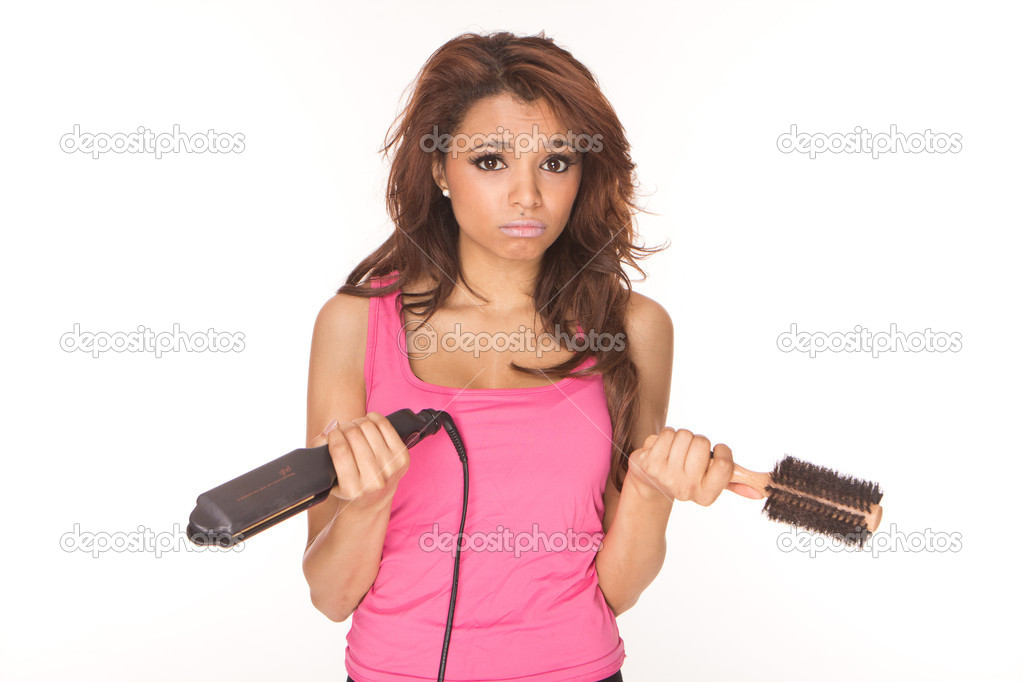 Troubled beautiful brunette with hair iron straightener and brush — Stock Photo #5040696