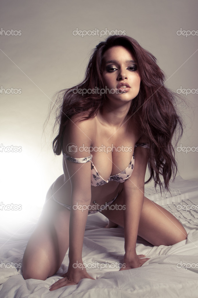 Young beautiful brunette woman wearing sexy lingerie in studio — Stock Photo #5142664