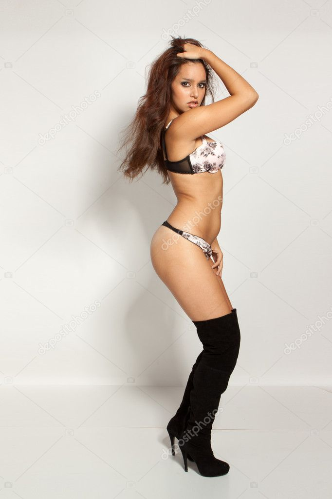 Young beautiful brunette woman wearing sexy lingerie in studio — Stock Photo #5142693
