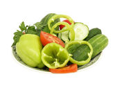 Plate with fresh vegetables.Isolated. — Stock Photo