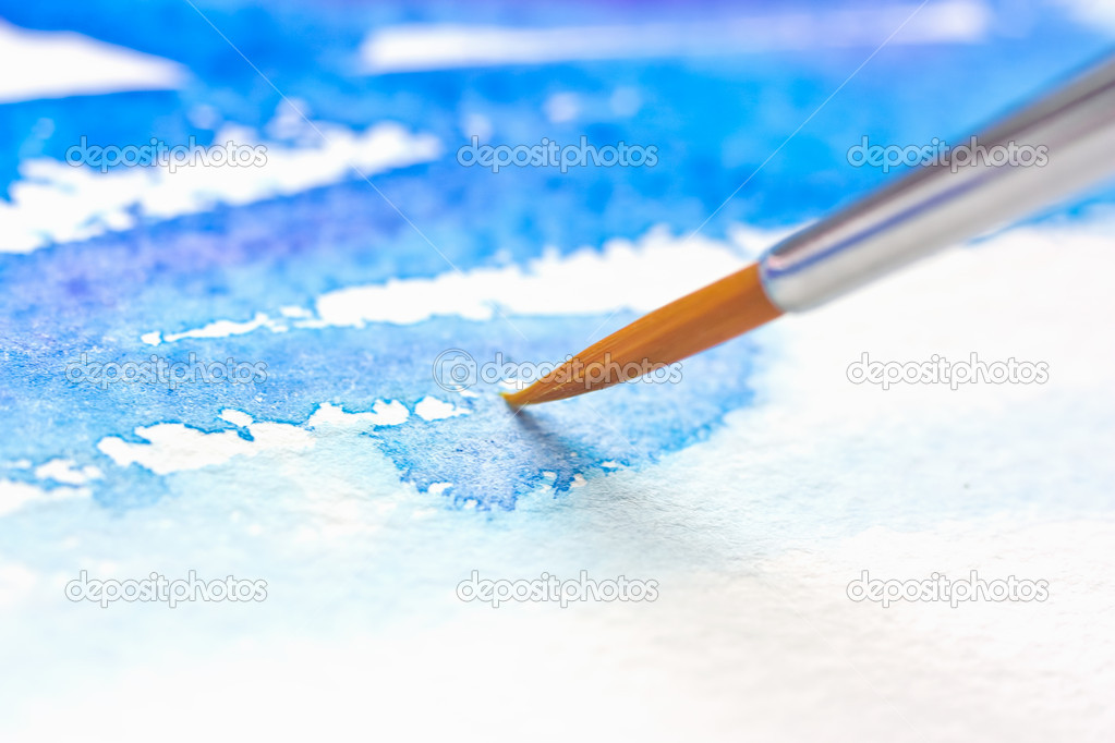 Paint brush on the paper with watercolor painting — Stock Photo #5374385