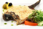 Fried fish with cream sauce — Stock Photo