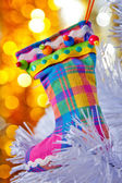 Decorative boots on a white Christmas tree. — Stock Photo
