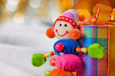 Decorative snowman with present box — Stock Photo