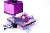 Open purple gift box with a rose isolated. — Stock Photo