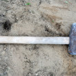 Stock Photo: Hammer - Building hammer tool on earth