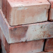 Brick a stack of bricks as a background in close-up — Stock Photo