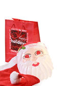 Christmas shopping with Santa Claus mask and cap — Stock Photo